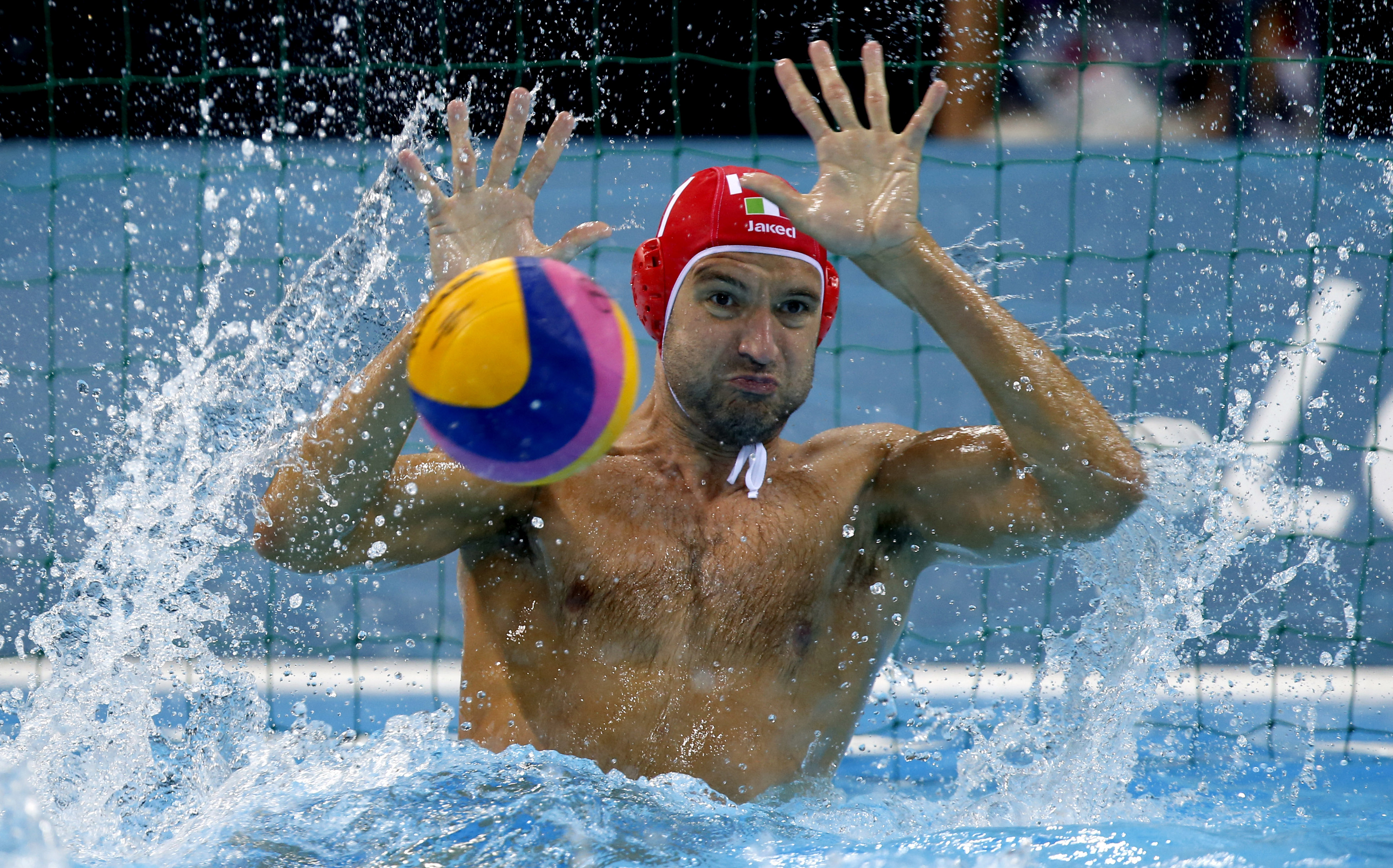 Italy goalkeeper Stefano Tempesti makes a save on a shot by Spain during a preliminary men's water polo match at the 2012 Summer Olympics, Monday, Aug. 6, 2012, in London. (AP Photo/Julio Cortez)